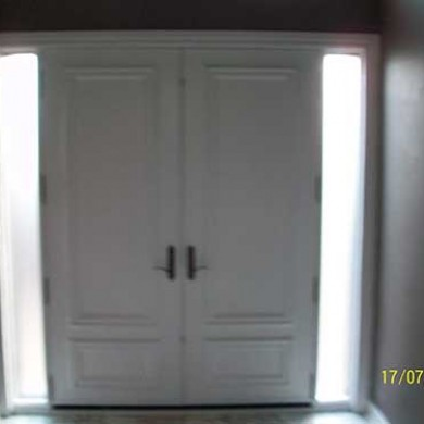 8 foot Smooth Fiberglass Solid Doors installed - Inside View by Fiberglass Doors Toronto