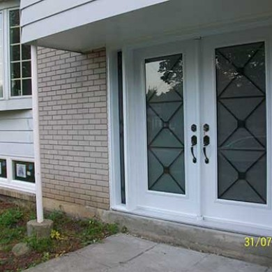 Excalibur Smooth Fiberglass Doors with Multi Point Locks and Side Lights installed by Fiberglass Doors Toronto