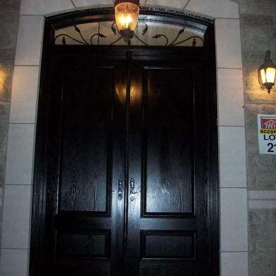 Fiberglass Executive Doors, Double Solid Fiberglass Woodgrain Door with Matching Arch Transom Installed in Niagara Falls by Fiberglass Doors Toronto