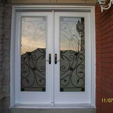 Jullietta Smooth Exterior White Fiberglass Doors with Multi Points locks installation by Fiberglass Doors Toronto