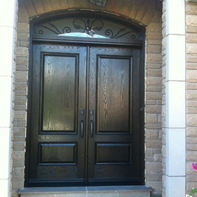 Solid Woodgrain Fiberglass Doors with Arch iron Transom Installed by Fiberglass Doors Toronto