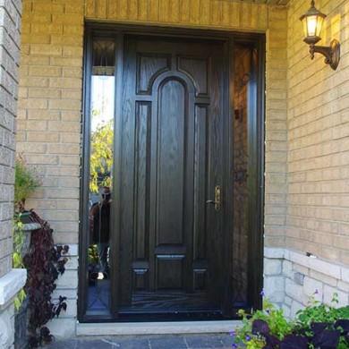 Fiberglass Door-Fiberglass Woodgrain Single Solid front Door with 2 Iron Art Side Panel Lights Installed by Fiberglass Doors Toronto in Brampton