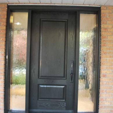 Fiberglass Door-Fiberglass Woodgrain Solid Front Door with 2 Frosted Side Lites Installed by Fiberglass Doors Toronto in Maple Ontario