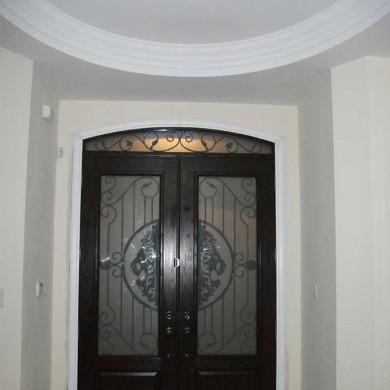 Fiberglass Door-Fiberglass Woodgrain Stained Glass Door with Matching Iron Arch Transom Installed by Fiberglass Doors Toronto in Oakville - Inside View