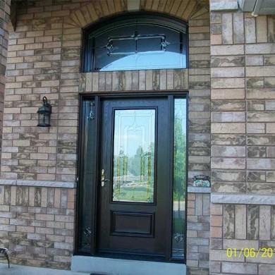 Fiberglass Door-Single Door Fiberglass Woodgrain with Stain Glass Design & Matching Arch Transom installed by Fiberglass Doors Toronto