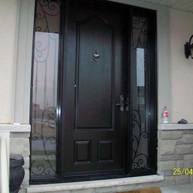 Fiberglass Door-Single Fiberglass woodgrain Door with 2 Iron Art Side Lites installed by Fiberglass Doors Toronto
