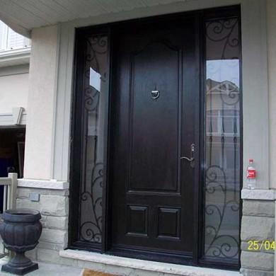 Fiberglass Door-Single Fiberglass woodgrain Door with 2 Iron Art Side Lites installed in Mississuaga installed by Fiberglass Doors Toronto