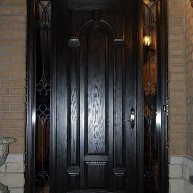 Fiberglass Door-Single Solid Fiberglass Woodgrain Front Door With 2 Side Iron Art Lites Installed by Fiberglass Doors Toronto in Barrie Ontario
