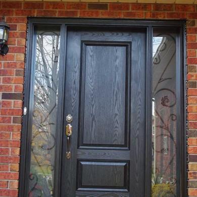 Fiberglass Door-Single Solid Fiberglass Woodgrain Front Door with 2 Iron art Side Lites Installed by Fiberglass Doors Toronto in Brampton Ontario