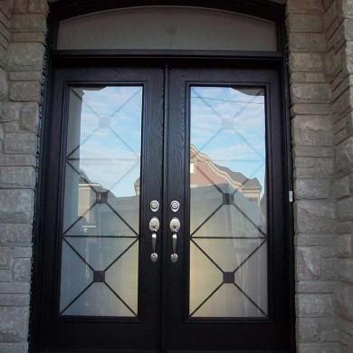 Fiberglass Door-Woodgrain Double Door Fiberglass with Iron Glass Design & Matching Arch Transom Installed by Fiberglass Doors Toronto in Barrie