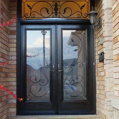 Fiberglass Door-Woodgrain Fiberglass Double Iron Art Glass Design Front Door with Iron Art Ransom Installed by Fiberglass Doors Toronto in Woodbridge