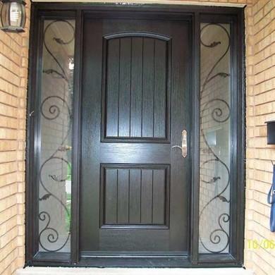Fiberglass Door-Woodgrain Rustic Fiberglass front Single Door with 2 Iron Art Design installed by Fiberglass Doors Toronto