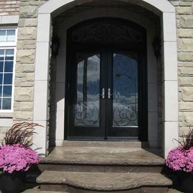 Fiberglass Doors, Woodgrain Stained Glass Iron Art Door with Matching Iron Arch Transom Installed by Fiberglass Doors Toronto in Richmondhill