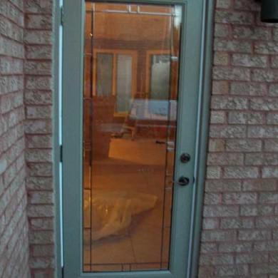 Flush Glazed Smooth Fiberglass Door installed by Fiberglass Doors Toronto