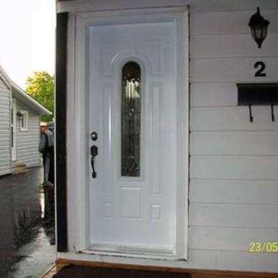 Smooth Exterior Fiberglass Door with Multi Point Locks installed by Fiberglass Doors Toronto