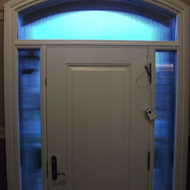 Woodgrain Fiberglass door with 2 side lites and arch transom - Inside View by Fiberglass Doors Toronto