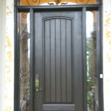 Rustic Front Entry Door with 2 Iron Art Side Lites and Transom installed in Toronto